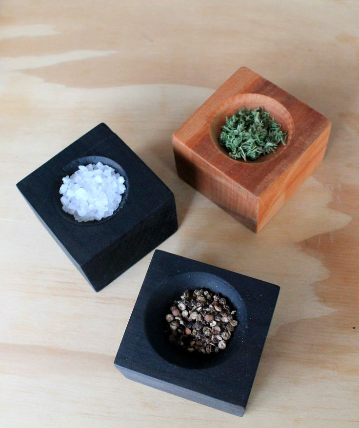Pinch pots useful for salt, pepper and herbs.  Available in black or natural wood.