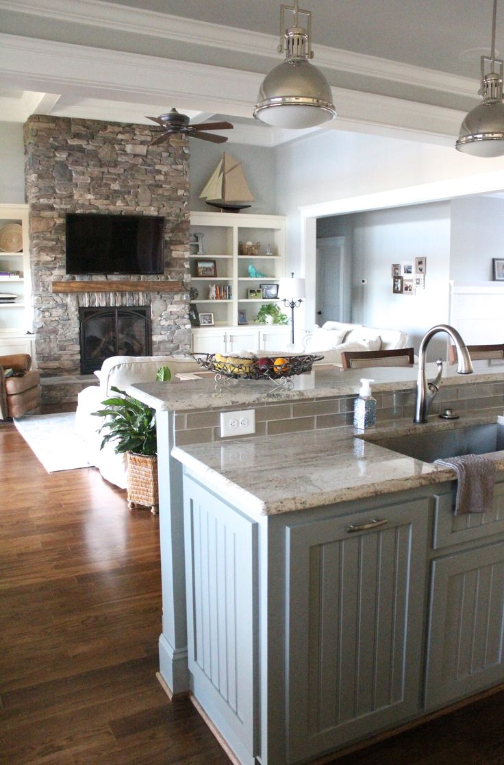 American style kitchen and living room - Home Of The Month Lake House Reveal Simple Stylings Kitchen Island Into Living Room Painted Cabinets Stone Fireplace