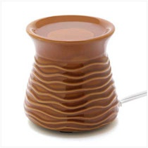 "Enjoy your favorite scented oil, totally hassle free. Flameless electric oil warmer features an attractive caramel ceramic base; generous well holds plenty of fragrance. Just plug it in and relax!Weight 1 lb. 4 1/4"" diameter x 4"" high. Stoneware. Oil not included.   	    Item:  14618    Price: $19.95  Sale Price: $11.97  (40% Off)"