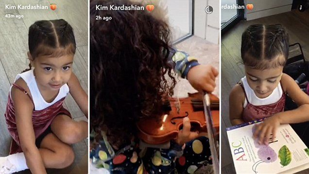 Music to Kim's ears! North performs violin and reads a book to Kim Kardashian. North sported her wild locks while playing a violin but went for a two french braids soon after.