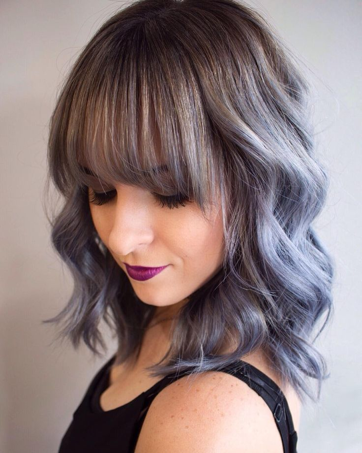 """Lunar blue"" blue/periwinkle pastel hair color with long, brow-skimming bangs by Aveda Artist Chelsea at Salon Norrell."