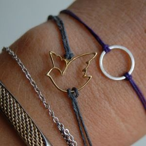 Take a favorite charm off a necklace or broken earring and add a string... So easy and so cute:)