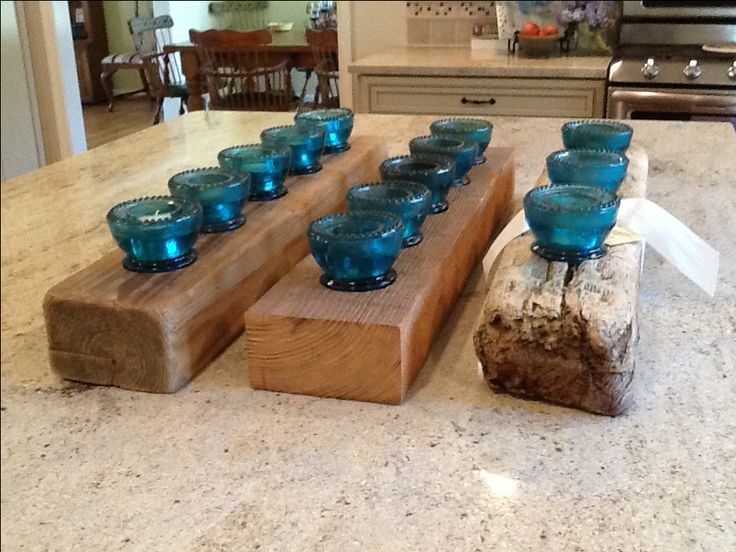More images of glass insulator candle holders of recycled wood.
