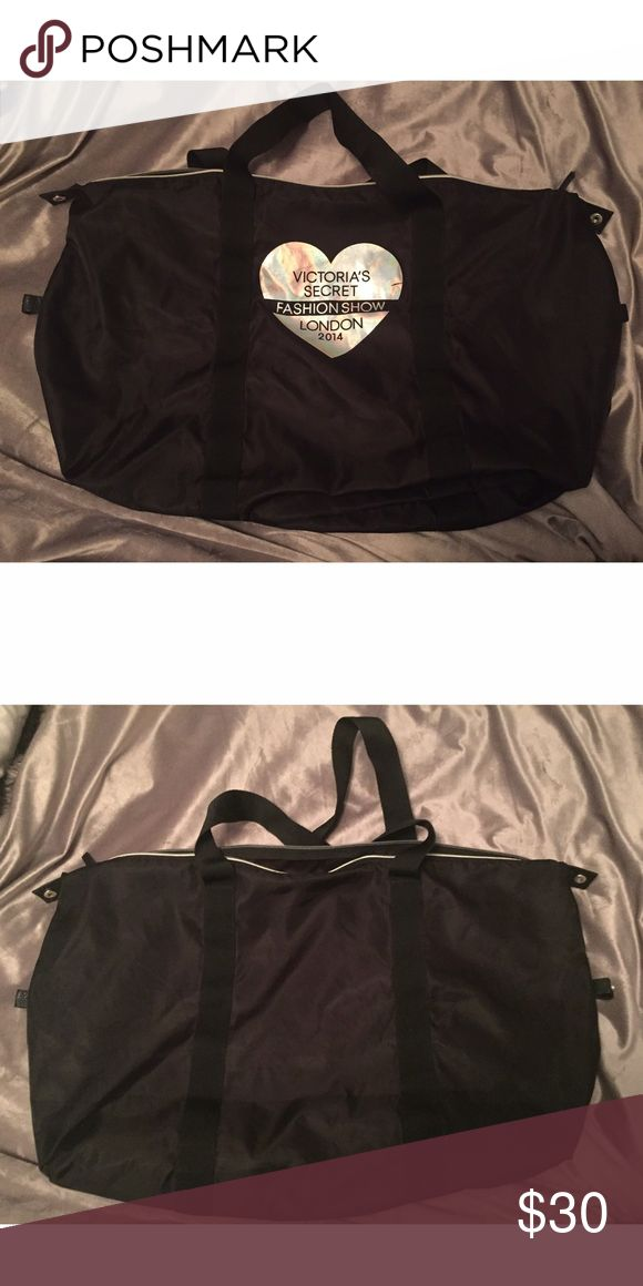 Limited Edition VS Fashion Show Bag Black and silver. Limited edition 2014 VS fashion show weekender. Very clean. Very large! Victoria's Secret Bags Travel Bags