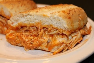 Crockpot Buffalo Chicken - just chicken, Frank's buffalo wing sauce & pkg of dry Ranch mix!  We are spicy lightweights so I will have to tone down the heat with less spicy sauce or adding cream or blue cheese, but def trying this out!