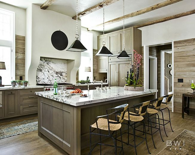 planked wood backsplash in kitchen- marble over range area- separated by hood  Beth Webb Interiors