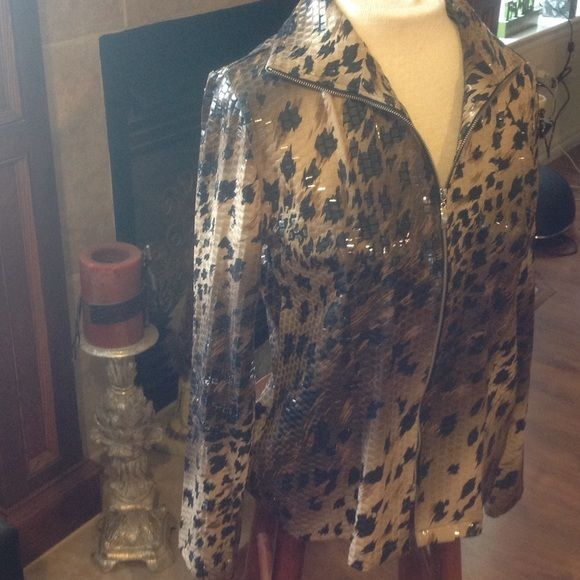 Very cool Jacket Very cool jacket kind of a leopard print.  Colors are brown, black and beige made of95% polyester and 5% spandex.  Has kind of a shiny look to it. Soos by misook Jackets & Coats