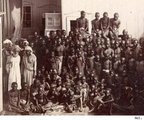 Slaves on a ship in Africa. Notice to the Left are the Moslem Slave Sellers.