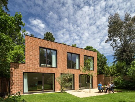 Tompkins Rygole's Woodridge house evokes Arts and Crafts architecture with brick facades