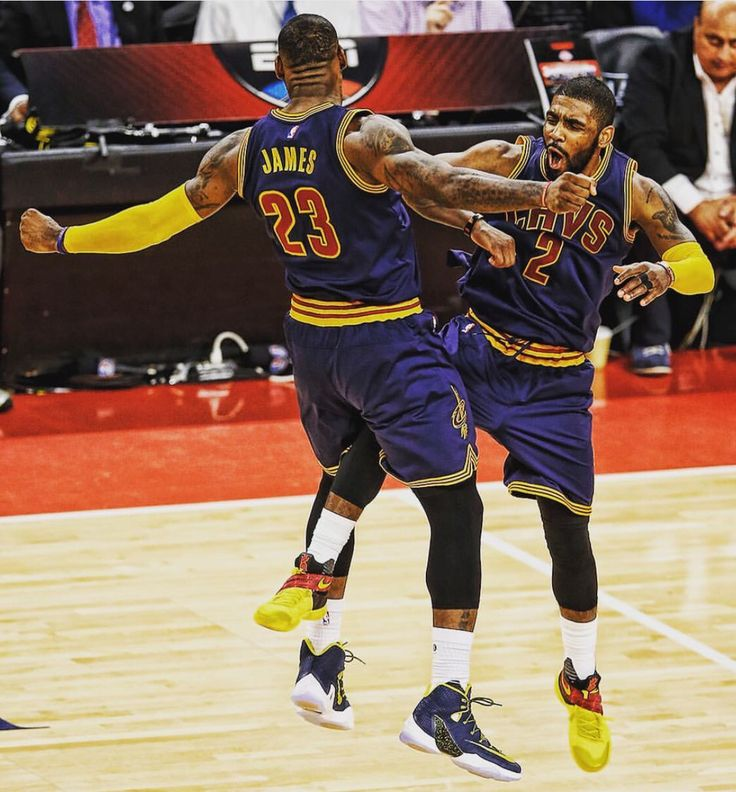 LeBron James and Kyrie Irving celebrating during Game 3 win against the Detroit Pistons