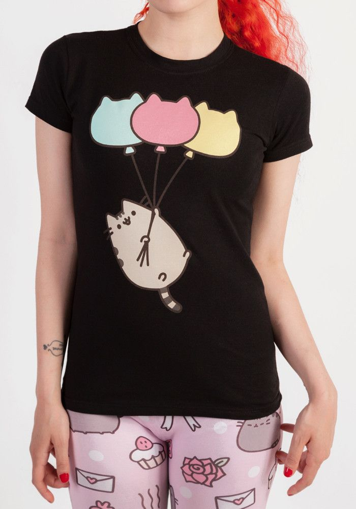 Pusheen can get carried away by cat balloons! This juniors tee features Pusheen being airlifted by 3 cat-shaped balloons!