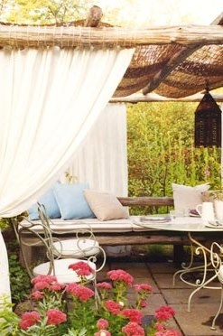 outdoor room with curtains