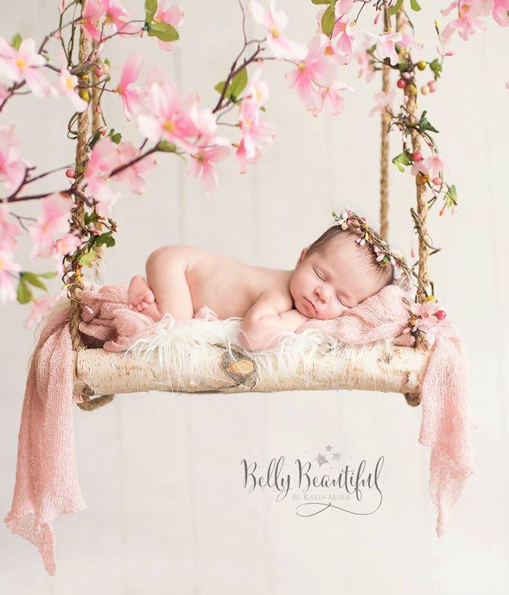 newborn baby girl pose swing flowers halo crown