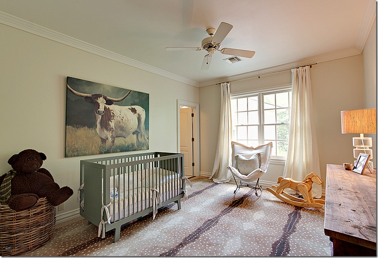 sophisticated nursery with antelope carpet