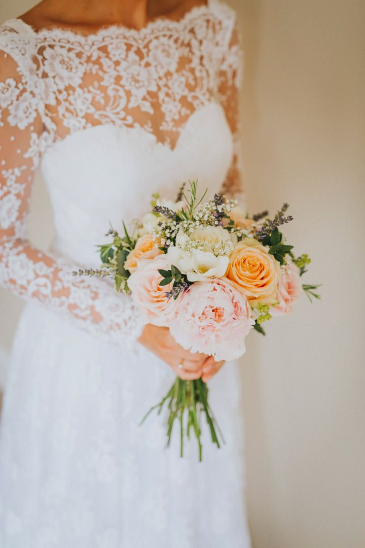 Beautiful blooms, beautiful dress, beautiful bride. Photo by Benjamin Stuart Photography #weddingphotography #weddingdress #weddingflowers #bridalbouquet #handtiedbouquet #gardenflowers #bride