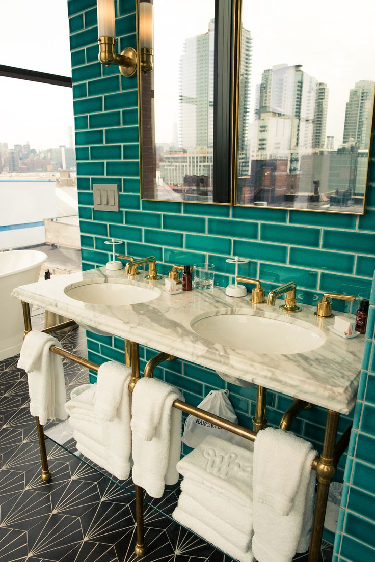 Take a First Look Inside the New Williamsburg Hotel: We had the chance to be one of the first guests to get a glimpse of the new property, and we can safely say it is poised. ---- Teal bathrooms bathrooms equipped with elegant brass fixtures. | Coveteur.com