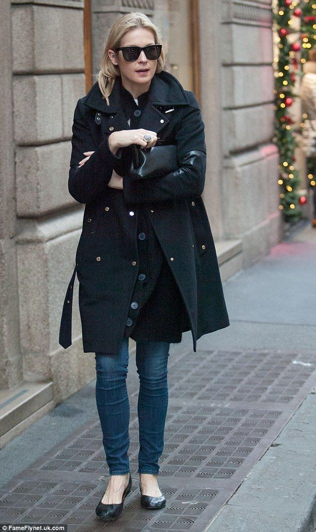 Chilled: The former Gossip Girl star was bundled up in a knee-length sweater and skinny je...