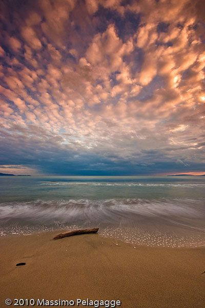 Pink sunset in the Golfo di Follonica, Maremma Tuscany Italy