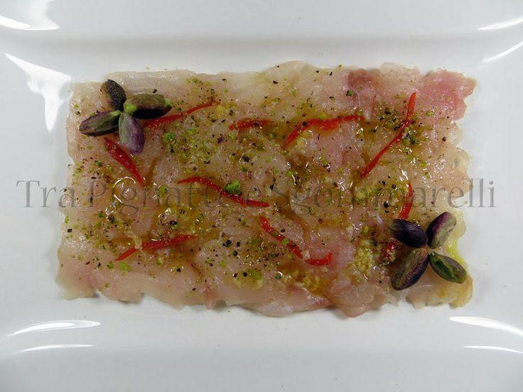 Carpaccio di spigola con pistacchi di Bronte, peperoncino, sale nero ed emulsione allo zenzero ...