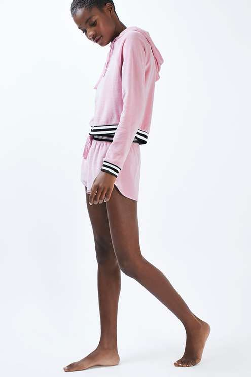 Take a step back into the noughties in this pink velour hoodie, featuring a contrast black and white striped waistband and cuffs. Team with matching velour loungewear shorts for ultimate impact. #Topshop