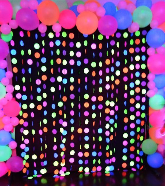The Photo Backdrop for the Neon Glow Party was so cool! I really enjoyed seeing all the kids (and adults lol) taking pictures with the Photo Props.(Diy Photo Backdrop)