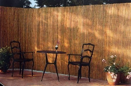 An inexpensive reed fence can be attached with wire or zip ties to cover up a chain link fence and provide privacy.
