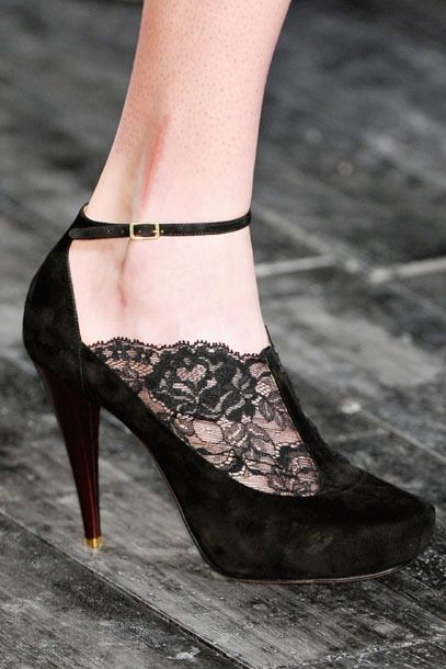 The delicate lace adds subtle sex appeal to a T-strap pump.