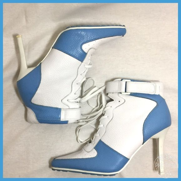 Unique heeled baby blue and white lace up booties Perfect for a UNC basketball fan! Like new court shoe boots from Sole City size 8 genuine leather excellent used condition only flaw is scuff on left toe in 3rd picture. Please ask questions Sole City Shoes Ankle Boots & Booties