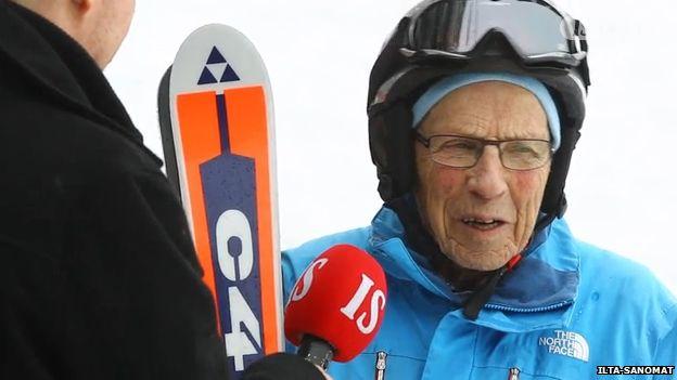 Nils-Olof Eklundh speaking to a reporter