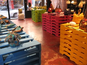 More pallets. Great idea for inexpensive store furniture.
