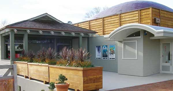 Matakana Cinema Complex, North of Auckland in New Zealand.  Finished in Resene Linen (green edged neutral) and Resene Raptor (murky green).