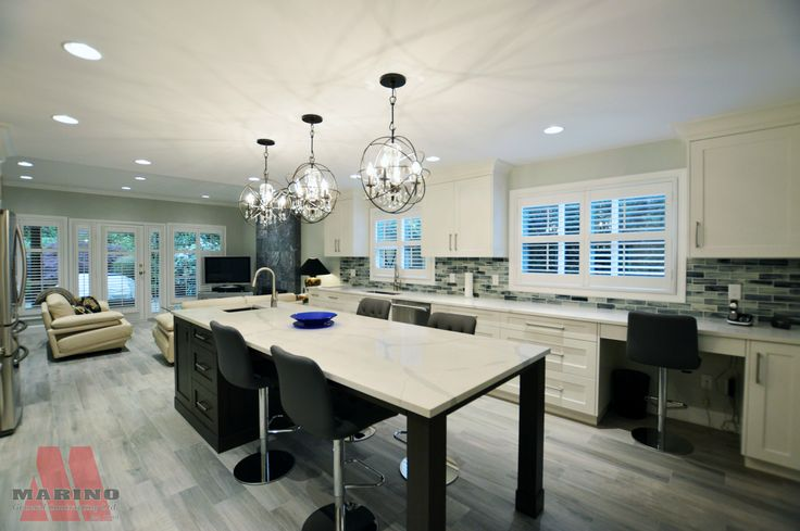 Open concept kitchen with exposed leg island