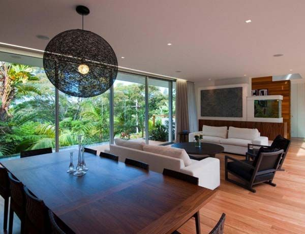 Living Room, Astonishing Open Living Room With Intriguing Pendant Lamp Astounding Dining Area Stunning Oval Coffee Table Exciting Chair Comf...