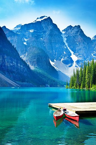 Lake Moraine and Canoe Dock in Banff National Park stock photo