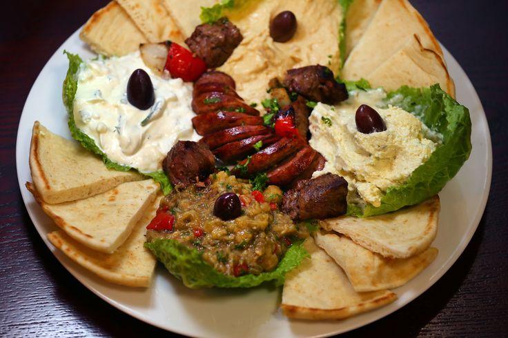 Meze Platter - Spicy Feta, Hummus, Tzatiki Sauce, Eggplant and Loukaniko.