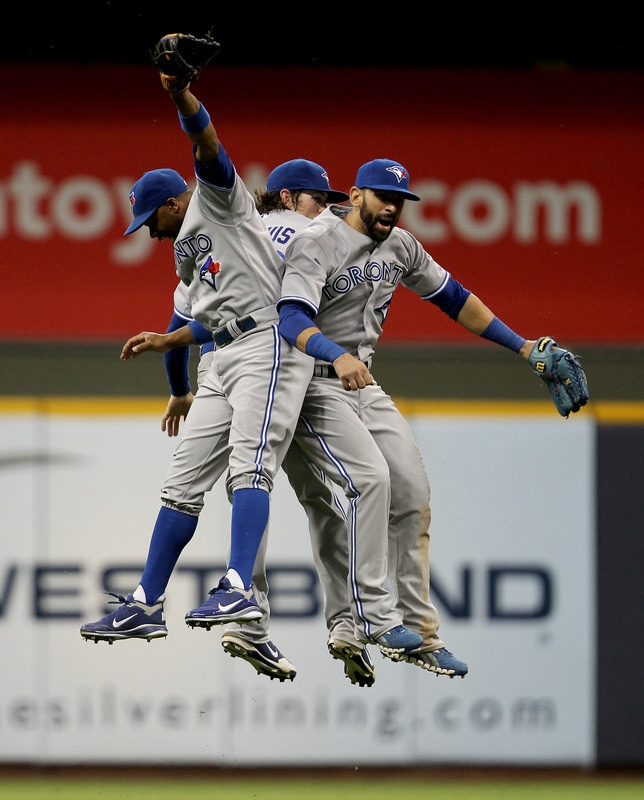 Jose Bautista #19, Colby Rasmus #28, And Rajai Davis #11 Of The Toronto Blue Jays Celebrate
