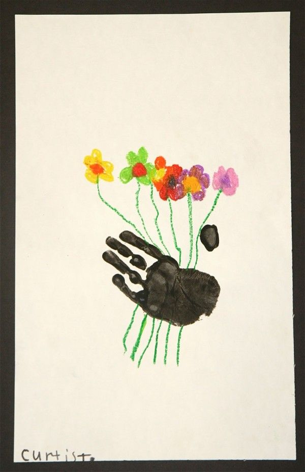 Handprints holding flowers plus MORE Mother's Day gift ideas