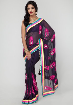 A blue coloured saree from Ethnic Closet. Made from georgette. Drape this trendy blue saree from Ethnic Closet to amaze everyone at the next wedding do this season. Designed in line with the latest trends, this saree features fine embroidery in bright pink colour. Wear it with matching jewellery and sandals for a perfect party look.
