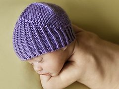 This baby hat was designed for the Period of Purple Crying Program at the IWK Health Centre. The PURPLE program educates parents about normal infant crying and teaches coping skills in order to prevent Shaken Baby Syndrome. Since purple is usually considered a more feminine colour… how about a purple knight's helmet for little boys?