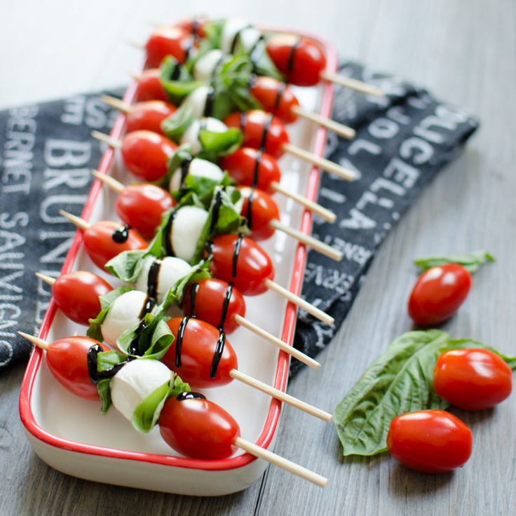 I like to use the little six inch skewers. You can easily fit a few pieces on the sharp end. For these caprese salad skewers you could slide on as many pieces of tomato and cheese as you like. I like the pattern of mozzarella between two leaves of basil and then two cherry tomatoes. Also, I like to use the mini bocconcini or fresh buffalo mozzarella. It's the same size as the cherry or grape tomatoes so it looks pretty and minimizes prep time.