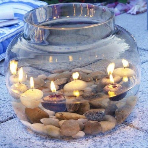 Stilistische Außendekoration mit Flintsteinen - Vase mit Kerzen