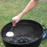 How to Clean a Grill- Forkin' onion. A quick, natural, and effective way to clean grill grates is to very simply take a white onion, peel it, cut it in half, stab a fork into the small end of one half, and use the fork to rub the onion back and forth over the grates of a hot grill. The onion not only deglazes the grill grates, it also adds an extra layer of flavor to whatever you're grilling.