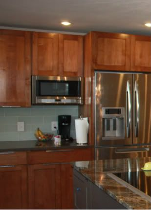 """over counter microwave next to stove... don't have to pay hundreds for """"microwave shelf"""" cabinet"""