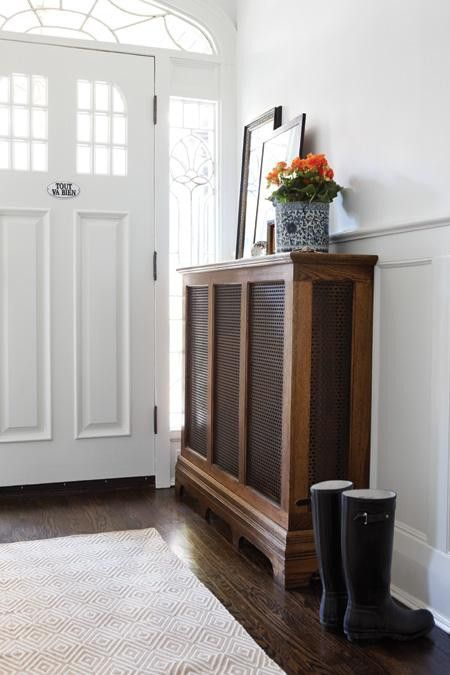 Minimalist entry hall plus a lovely radiator cover.