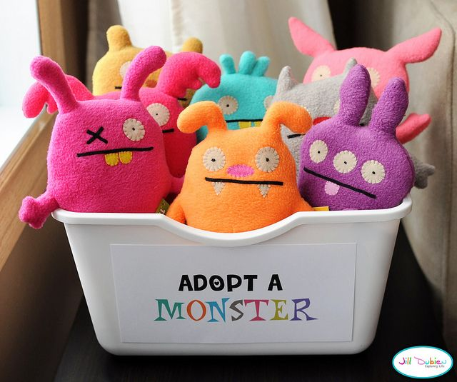 """Reading Buddies! Adapted from a birthday party idea. We used to read to small stuffed animals in my classroom, but this is even cuter! I love the way this looks with the colorful animals all together ... and """"Adopt a Monster""""?? Sooo clever and appealing!"""