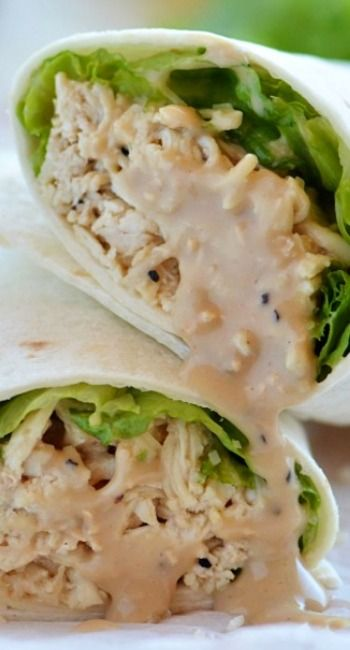 Crock Pot Chicken Caesar Wraps - Flavorful Caesar chicken, lettuce and Parmesan cheese wrapped inside a flour tortilla.