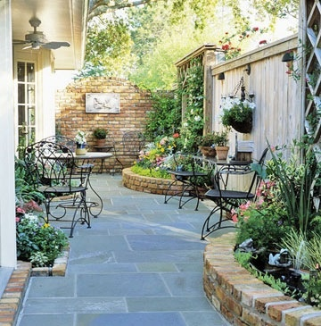 Big pavers with raised brick beds. Lovely