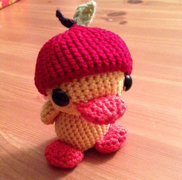 Crochet duck with an apple hat.