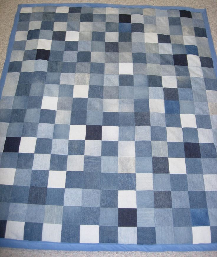 "These quilts are made out of 5""x5"" squares cut out of old pairs of jeans. They can be cut out of any article of clothing or any other cloth. This quilt is also backed in fleece. The jean quilt is a bit heavier than other fabrics."