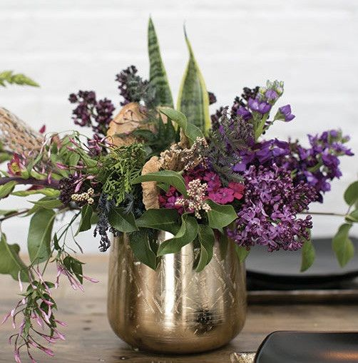 Get stylish gold floral containers for your DIY wedding centerpieces and home vase arrangements like this beautiful gold metal floral pot from the Tulum Collection. This modern round vase has decorati